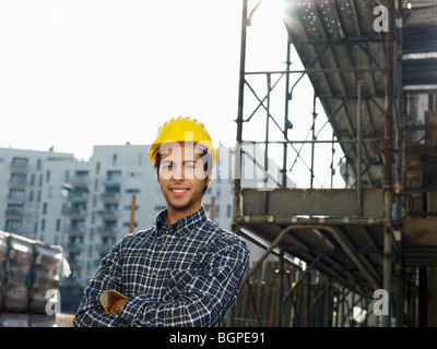 construction worker looking at camera - Stock Photo