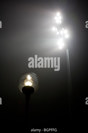 Stadium lights and streetlamp at night - Stock Photo