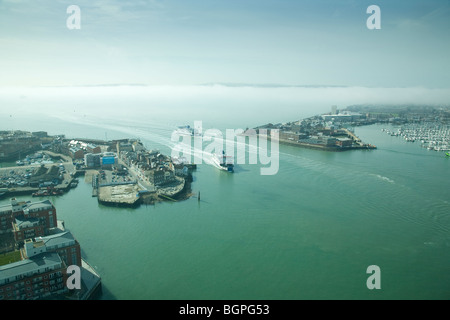 Ferries entering/leaving Portsmouth Harbour with mist covered Isle of Wight in the background, viewed from the Spinnaker - Stock Photo