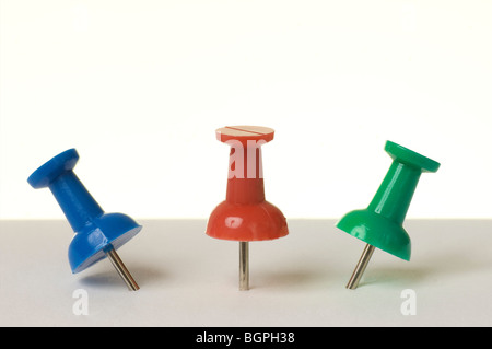Three colourful Drawing pins - Stock Photo