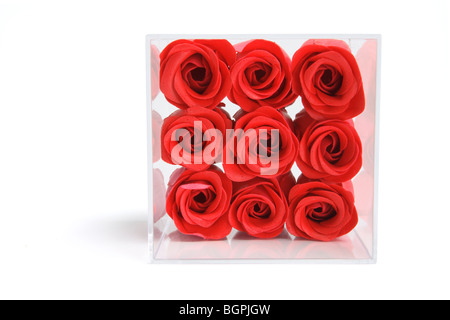 Artificial Red Roses in Plastic Box - Stock Photo