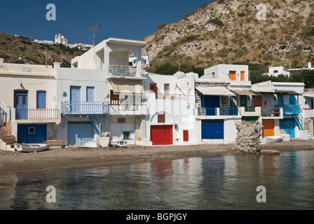 Brightly painted fishermen's houses in the seaside hamlet of Klima, Milos Island, Greece - Stock Photo