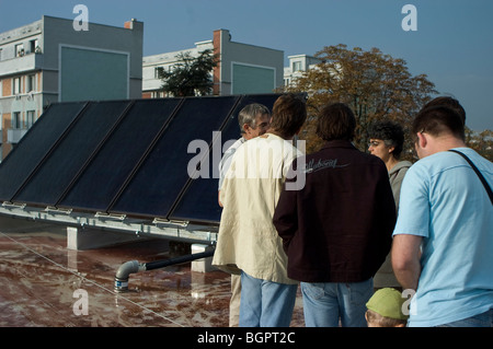 Montreuil, France, Open House Solar House in Paris Suburbs, People Visiting Roof of Building with Solar Panels - Stock Photo