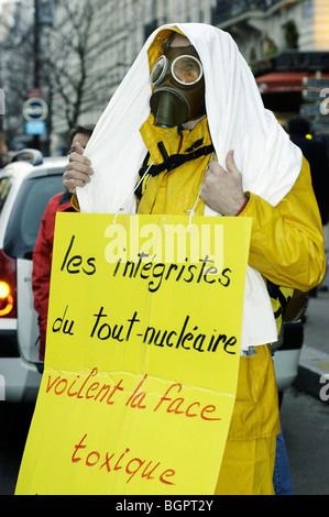 Paris, France, Anti-Nuclear Power Demonstration, with Man Dresses as Islamic Extremist, Carrying sign - Stock Photo