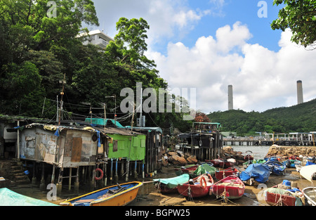 Informal stilt dwellings of Lamma fisherfolk, looking towards the jetty at Yung Shue Wan, Lamma Island, Hong Kong, - Stock Photo