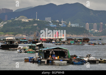 Rafts and dwellings of the Lamma Fisherfolk's Village, looking towards Aberdeen Ocean Park, Sok Kwu Wan, Lamma Island, - Stock Photo