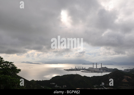 Silhouette shot of Lamma Power Station and the South China Sea, from the heights of Ling Kok Shan,  Lamma Island, - Stock Photo