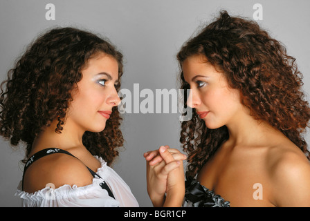 Portrait of twins face to face - Stock Photo