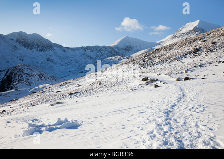 View to Mount Snowdon peak with snow on Miners Track in mountains in winter. Snowdonia National Park (Eryri) in - Stock Photo