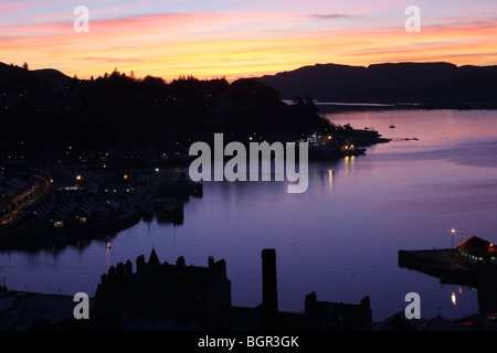 Sunset over Oban Harbor, Oban (Argyll, Scotland) view from McCaig's Towet - Stock Photo