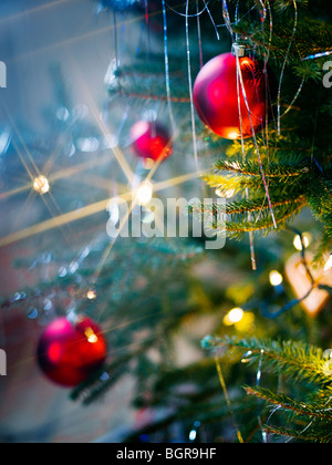 Decorations in a Christmas tree, Sweden. - Stock Photo