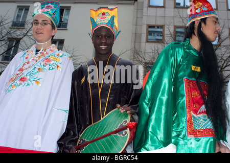 Paris, France, group of diverse teenagers, Teens in Traditional Costumes Parading in 'Chinese new year' Carnival - Stock Photo