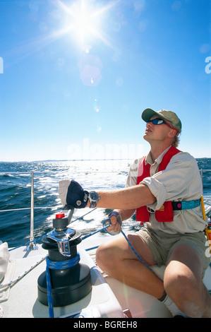 Man on a sailing-boat at sea, the Baltic Sea. - Stock Photo