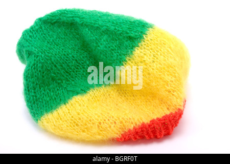 Knitted wool bonnet / hat in the rastafarian colours. - Stock Photo