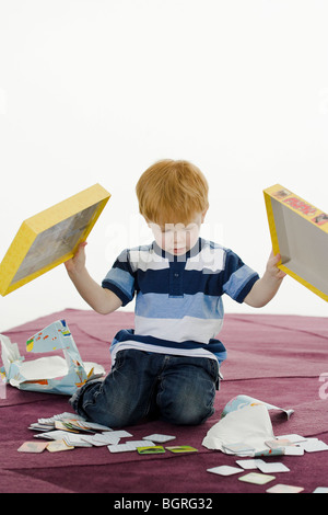 Little boy with a gift. - Stock Photo