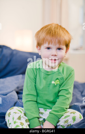 A little boy in bed, Sweden. - Stock Photo