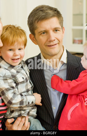 A family with two small children, Sweden. - Stock Photo