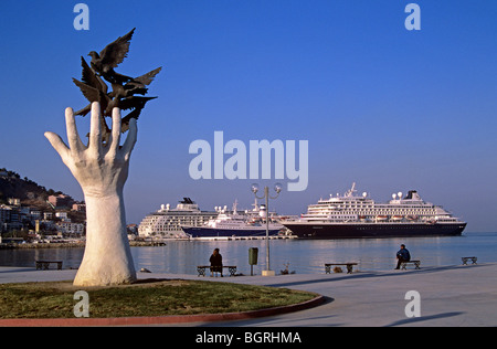 Modern sculpture on the waterfront near ferry port in the resort of Kusadasi - Stock Photo