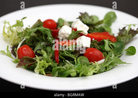 Authentic Traditional Greek Style Salad With Crumbled Fresh Feta Cheese Served In A White Bowl With No People - Stock Photo