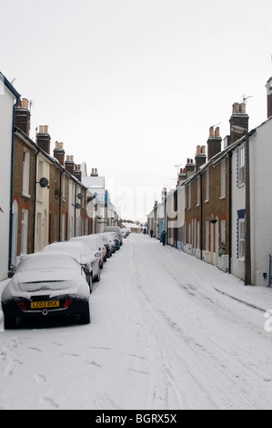 Back street covered in Snow on beach whitstable kent countryside england UK - Stock Photo