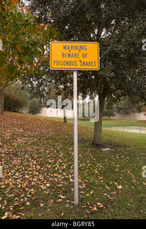 rest stop area along Florida interstate highway caution danger poisonous snakes - Stock Photo