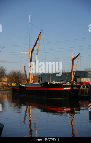Thames Barges at their winter mooring at sunset on the River Lea, Tottenham, London, England - Stock Photo