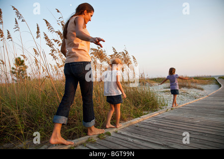 MR Mother and Daughters at Tower Beach in late afternoon, Hilton Head, South Carolina, USA - Stock Photo