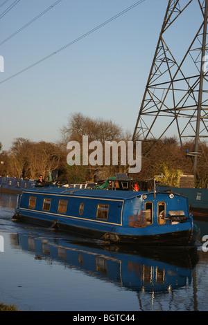 Narrowboat at sunset on the River Lea, Tottenham, London, England - Stock Photo