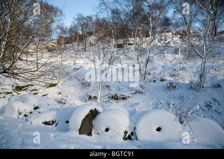 Abandoned millstones at Lawrencefield quarry between Bakewell and Sheffield in the Peak District Nation Park, UK - Stock Photo
