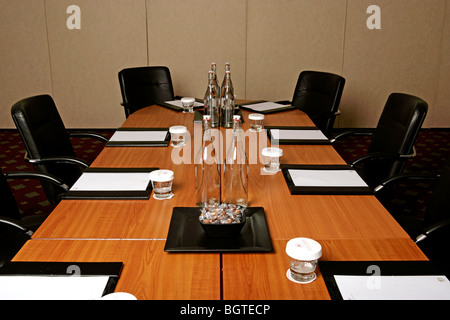 Conference Room Tables Set For A Meeting Complete With Water - Conference room table set