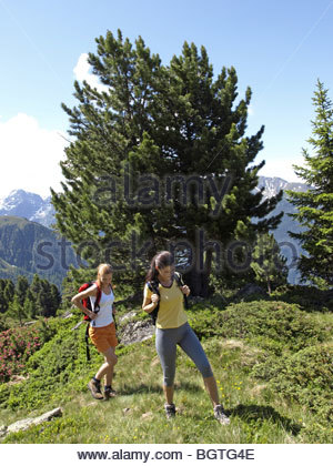 young woman hiking in moutains - Stock Photo