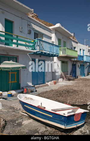 Syrmata - brightly painted fishermen's boat houses in the fishing village of Klima, Milos, Greece - Stock Photo