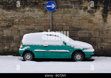 Volkswagen Polo car parked in snow, UK - Stock Photo
