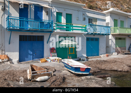 Syrmata - brightly painted boat houses in the fishing village of Klima on Milos Island, Greece - Stock Photo