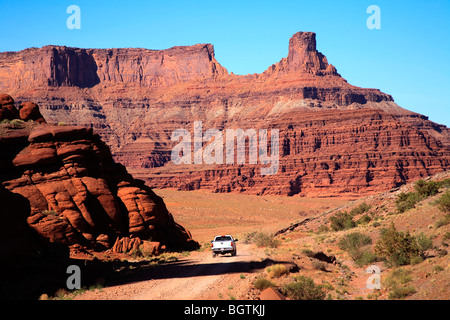 White Dodge truck on the Shafer Trail, Canyonlands National Park near Moab, Utah, USA - Stock Photo