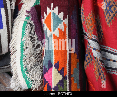 Traditional textiles on sale in Souq Waqif, Doha. - Stock Photo