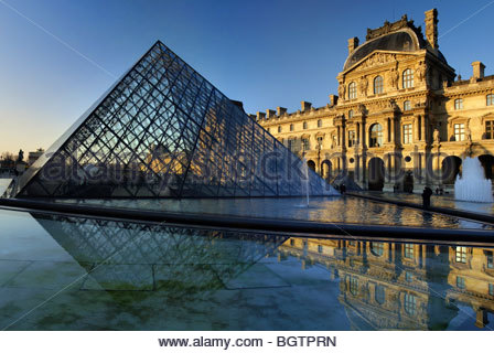 Paris : sunset over the Carousel du Louvre and the Pyramid - Stock Photo