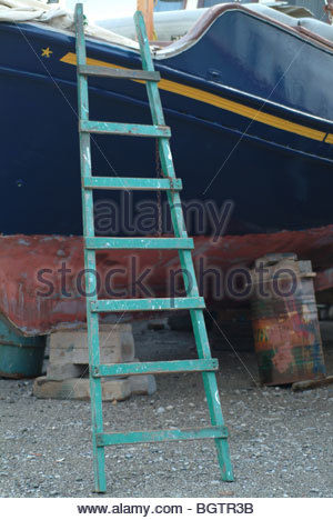 Wooden stepladder leading to a boat in drydock Greece - Stock Photo