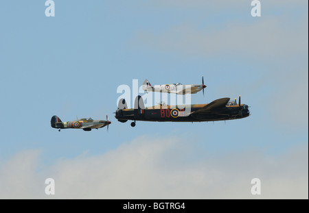 Battle of Britain memorial flight, Lancaster Spitfire and Hurricane aircraft in formation over Oxfordshire, UK. - Stock Photo