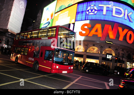 Red double-decker bus in front of the neon sign at Piccadilly Circus, London, England, United Kingdom, Europe - Stock Photo