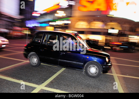 Taxi at Piccadilly Circus, London, England, United Kingdom, Europe - Stock Photo
