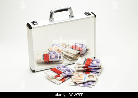 Bundles of Tens &Twenties  Bank notes Reflected in Silver Brief Case - Stock Photo