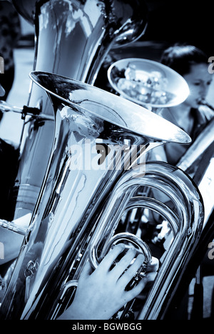 Tubas and euphoniums, lower brass musical instruments, being played by a group of musicians. - Stock Photo