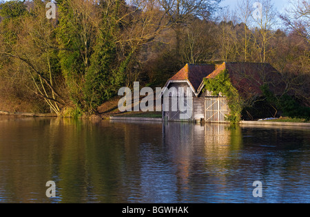 a pair of traditional riverside wooden boat houses on the Thames upstream of Hambleden Weir Mill End Buckinghamshire - Stock Photo