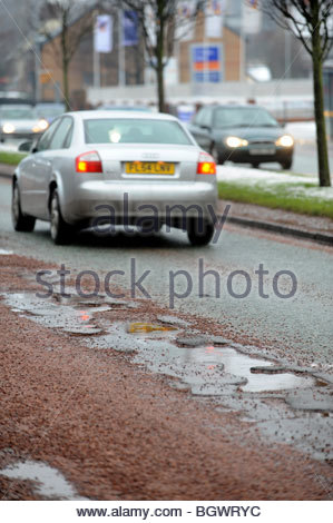 Pot holes on a busy road in Wolverhampton, United Kingdom. - Stock Photo