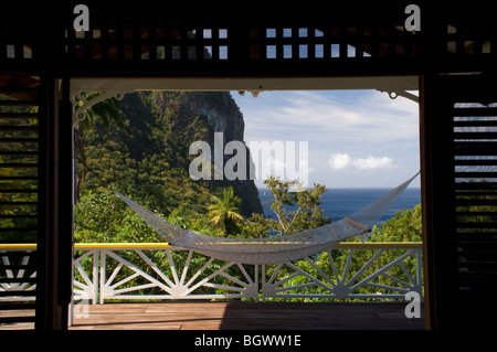 A hammock on the porch of a cottage in the Stonefield Plantation Resort, St Lucia, The Windward Islands, The Caribbean - Stock Photo