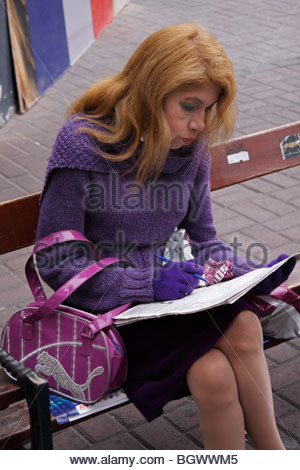 Purple lady: Sunday afternoon in Kennedy Park, Miraflores area of Lima, Peru - Stock Photo