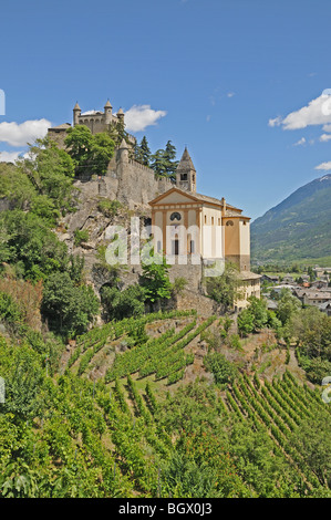 Saint St Pierre Castle Castello Parish Church and square bell tower 4 km west of Aosta Italy with alpine mountains - Stock Photo