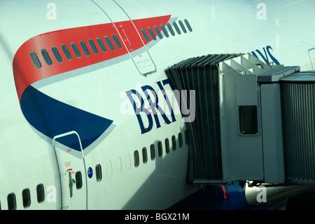 UK.British Airways aeroplane being serviced, ready for departure at Terminal 5,Heathrow,London - Stock Photo
