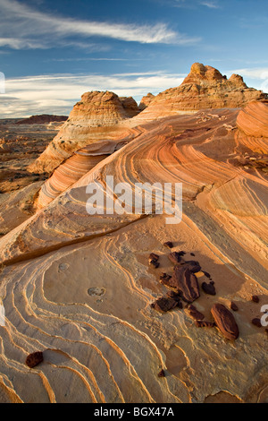 Swirling sandstone rock formations in Coyote Buttes South - Stock Photo